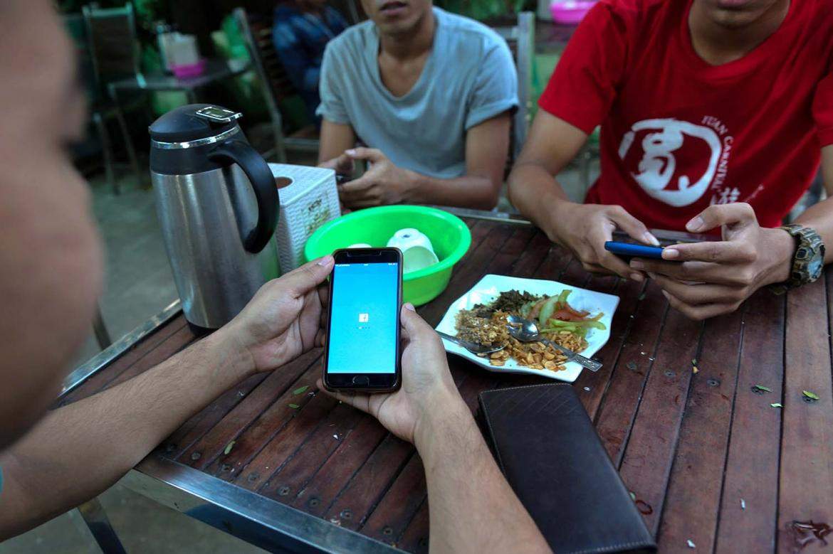 Rakhine netizens face a mobile internet block while dining at a teashop on February 20, 2020.
