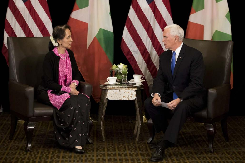 State Counsellor Daw Aung San Suu Kyi and United States Vice President Mr Mike Pence hold a bilateral meeting on the sidelines of an ASEAN Summit in Singapore on November 14. (AFP)