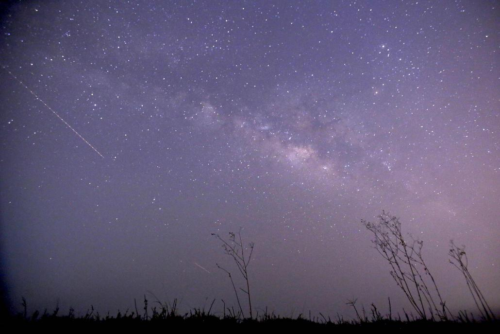 A long-exposure photograph shows a meteor shower passing near the Milky Way in the clear night sky of Thanlyin, on the outskirts of Yangon. (AFP)