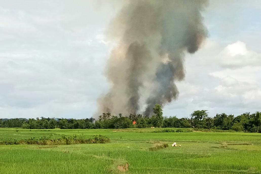 Smoke rises from what is believed to be a burning village in the area near Maungdaw on Wednesday. (AFP)
