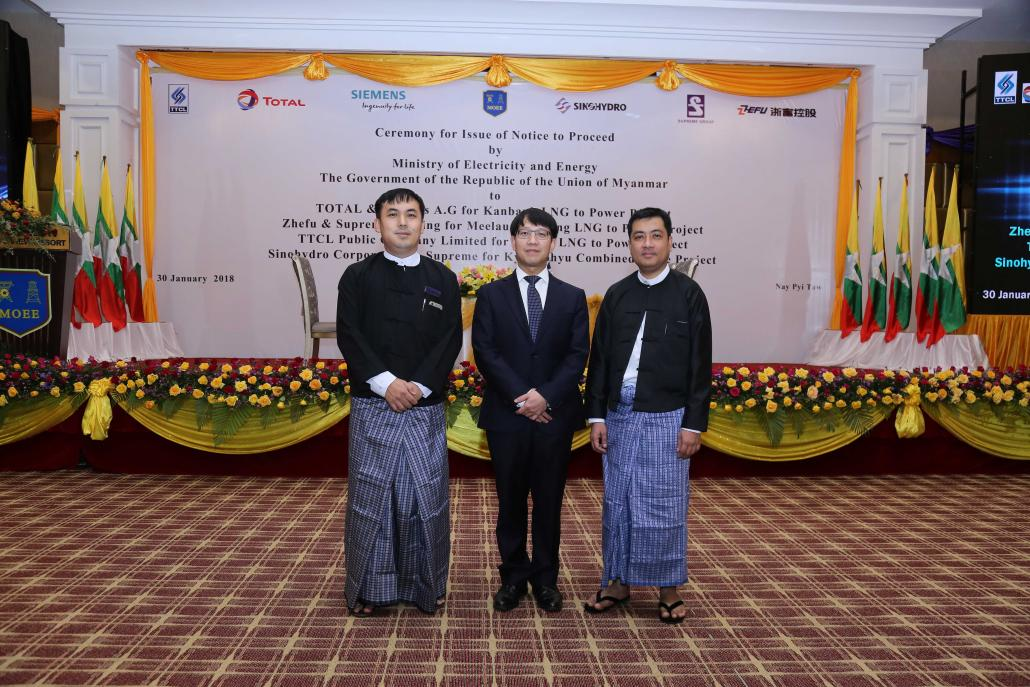 Representatives from Supreme Group and China's Zhefu Holdings in Nay Pyi Taw on January 30, the day they received a notice to proceed with a major power project from the Ministry of Electricity and Energy. (Supplied)