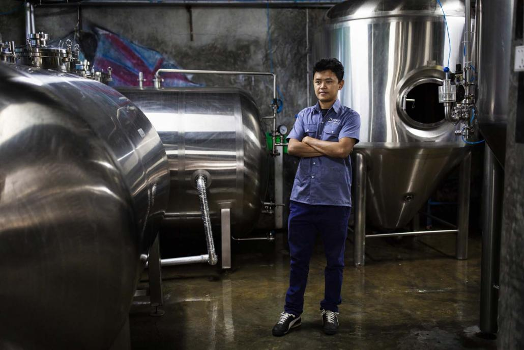 Ko Zaw Min Aung, head brewer at Burbrit. Three years after it opened, the country's first microbrewery is producing 10,000 litres a month, its founders say. (Hkun Lat | Frontier)