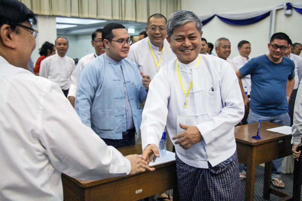 U Aung Kyi Soe is congratulated after being elected UMFCCI secretary general in 2016. (Nyein Su Wai Kyaw Soe | Frontier)