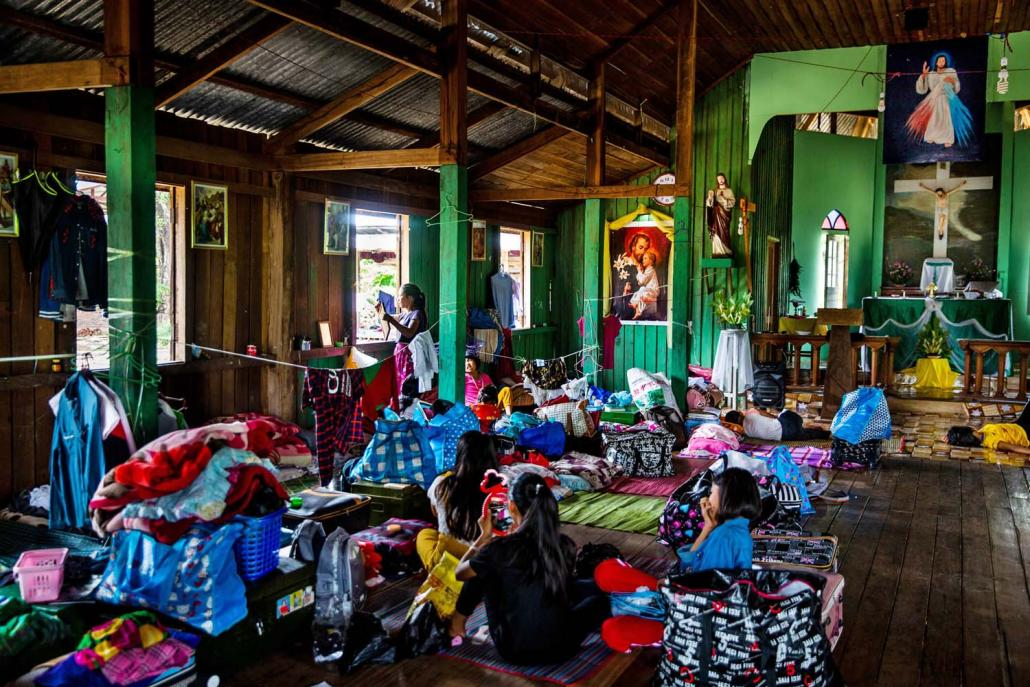 IDP students who have returned to Nam San Yang village sleep inside a Catholic church where they are temporarily staying. (Hkun Lat | Frontier)