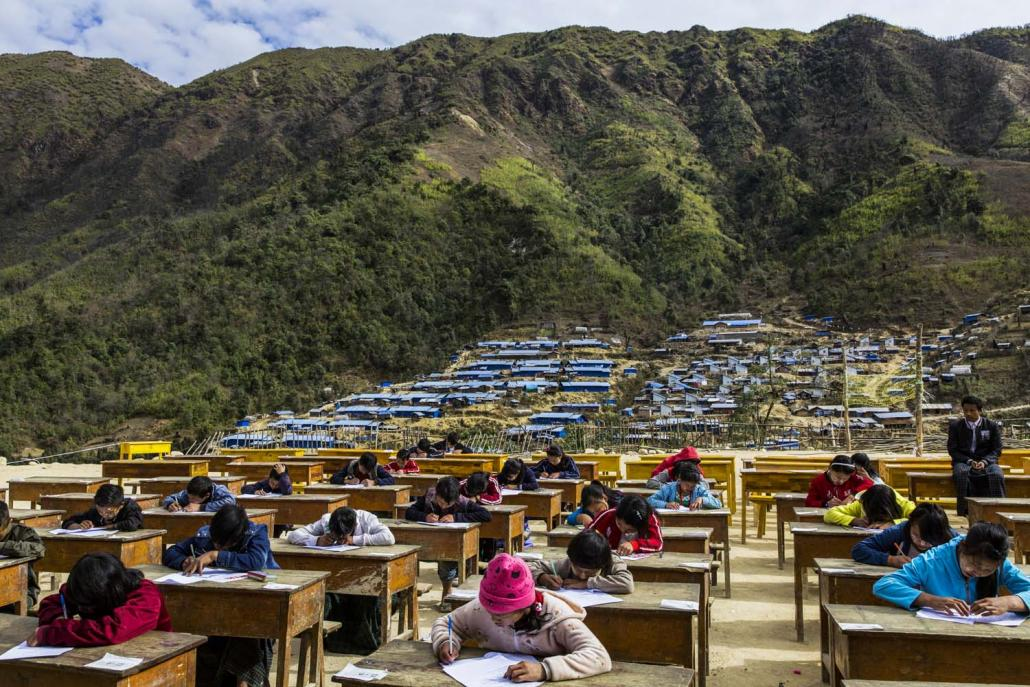 Youth displaced by conflict sit exams at the Hpare camp in Chipwi Township. (Hkun Lat | Frontier)