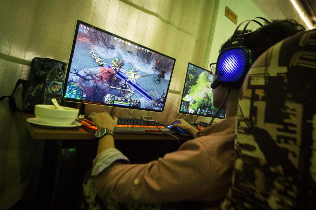 Probably the most popular title for Myanmar e-gamers is Dota 2, a fantasythemed strategy game and long-time favourite of the country's dim cyber cafés. (Teza Hlaing | Frontier)