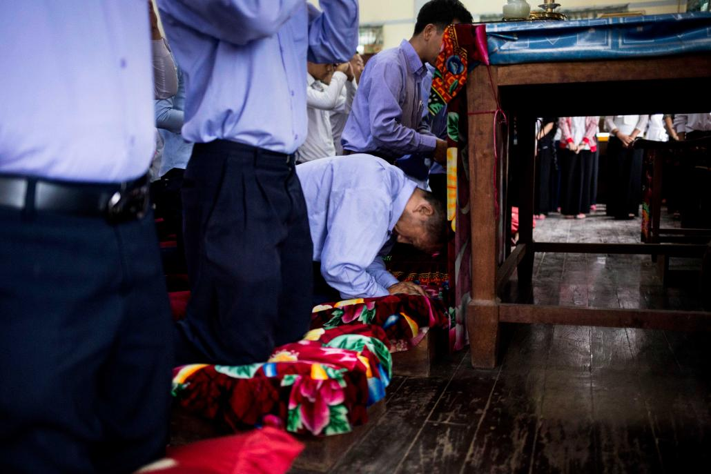 Aung Kyaw Oo takes part in prayers that mark the start of another school day. (Ann Wang / Frontier)