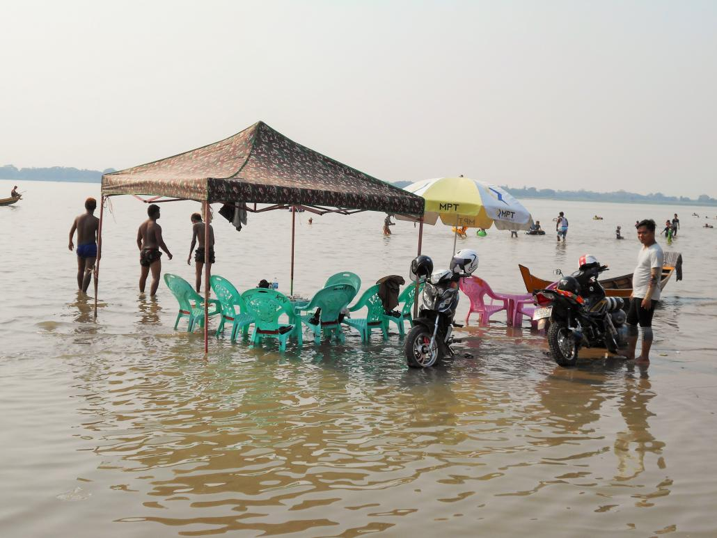 The riverside beach of Nyaung Chaungtha is a great place to meet locals. (Dominic Horner | Frontier)