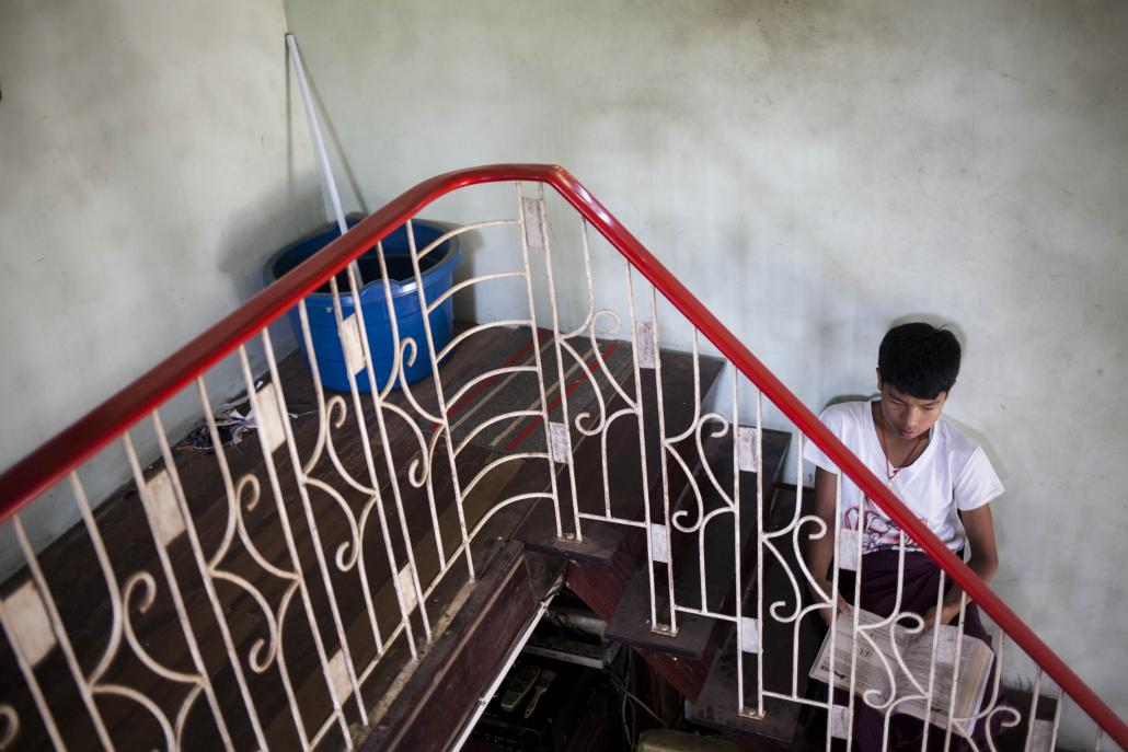 A student studies in the stairwell at BEHS 8 in Bago. (Ann Wang / Frontier)