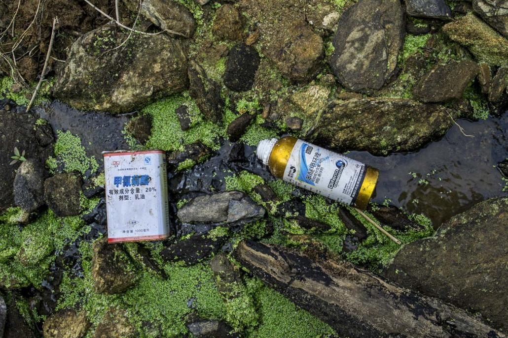 The ground of a tissue culture banana plantation in Mukchyaik village of Waingmaw Township was strewn with cartons of chemicals bearing instructions only in Chinese. (Hkun Li | Frontier)