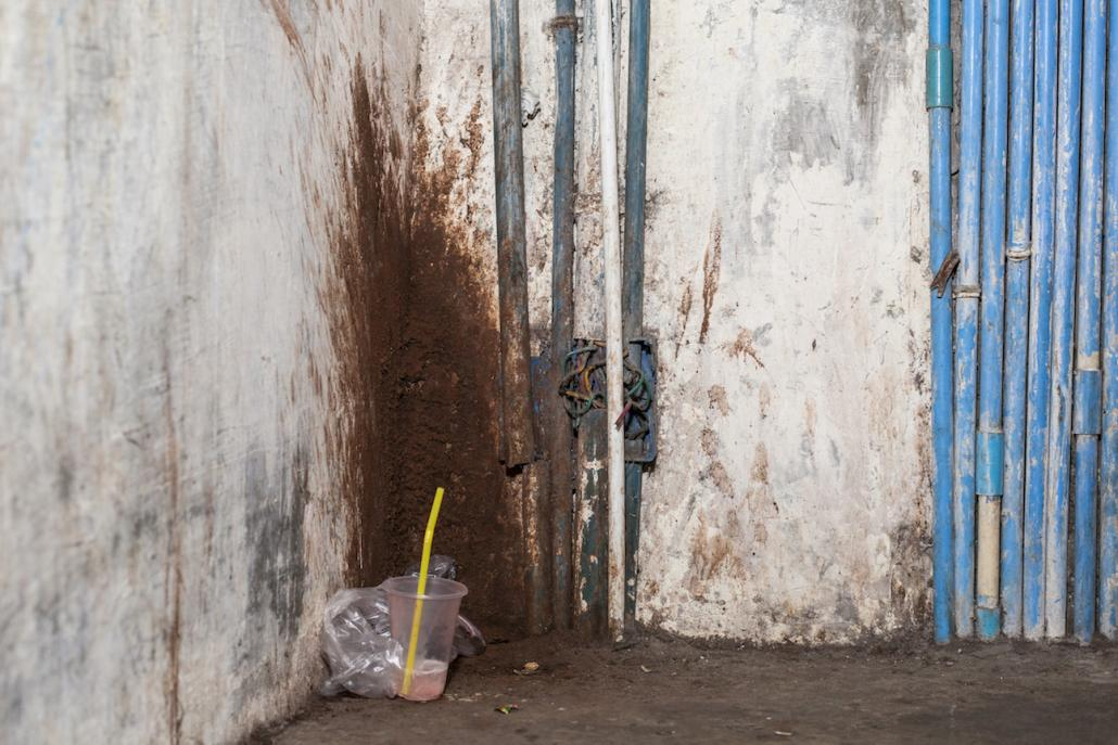 Betel stains in a staircase in downtown Yangon. (Chiara Luxardo / Frontier)