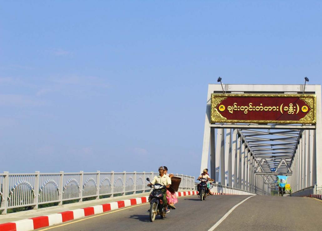 Motorcyclists cross the new bridge connecting Hkamti with the Naga Self- Administered Zone. (Oliver Slow | Frontier)