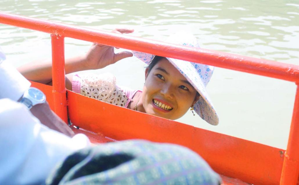 Ma Zaw Na Aye, who sells drinks and snacks on the boats that traverse the Chindwin River. (Oliver Slow | Frontier)