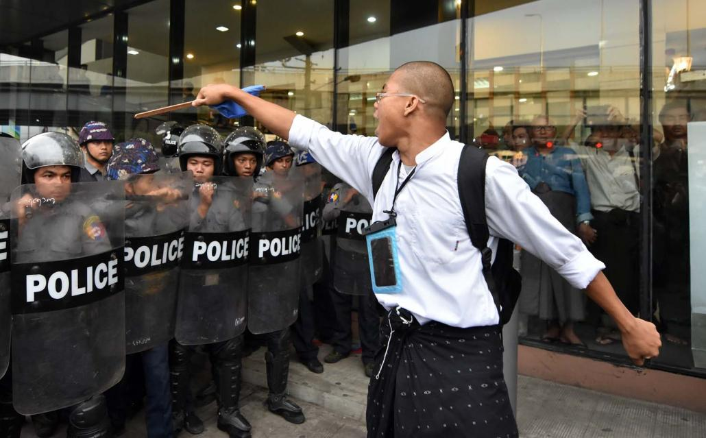 A peace rally in Yangon on May 12 turned violent when police moved in on protesters together with civilian vigilantes. (Steve Tickner | Frontier)