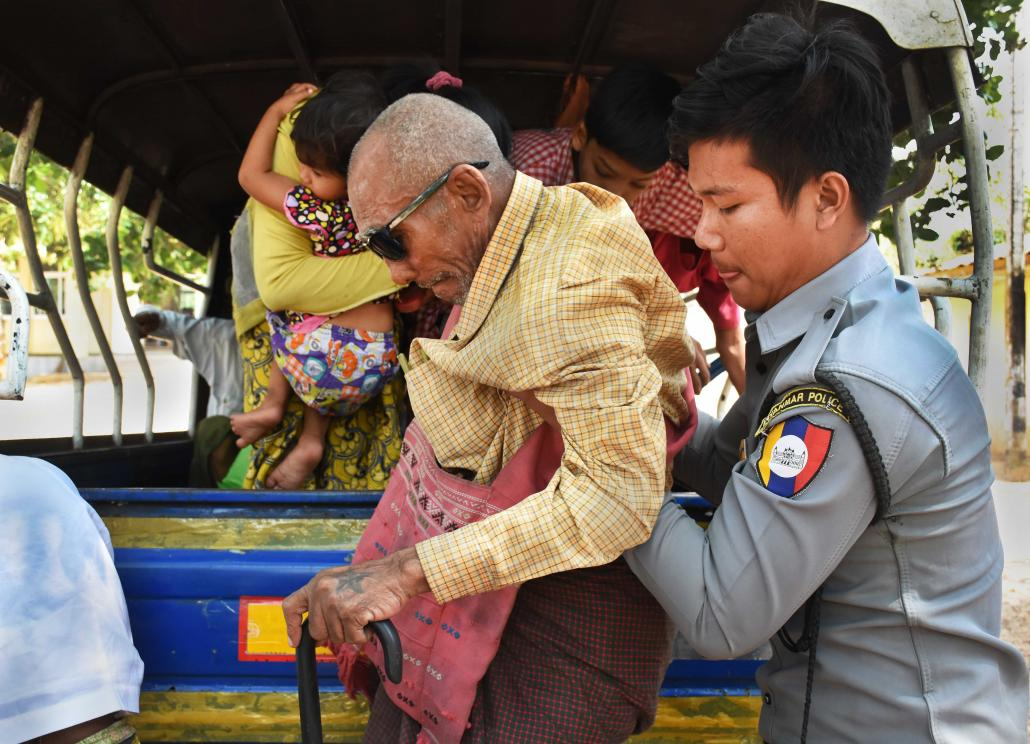 Police help U Khwe Lay out of a pickup truck at the Hmawbi social care centre on February 9. Twice a month police drop off people they have found begging in urban Yangon. (Steve Tickner | Frontier)