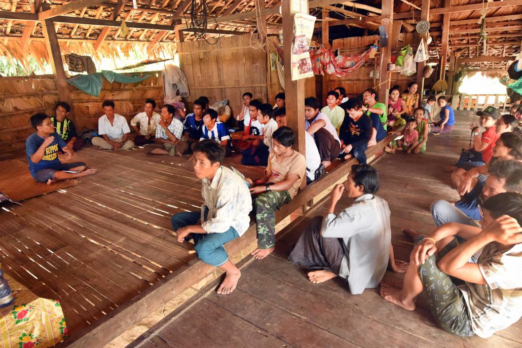 Residents gather at a hall in Chaung Sone village on February 11 to discuss their concerns about the national park proposal. (Steve Tickner | Frontier)