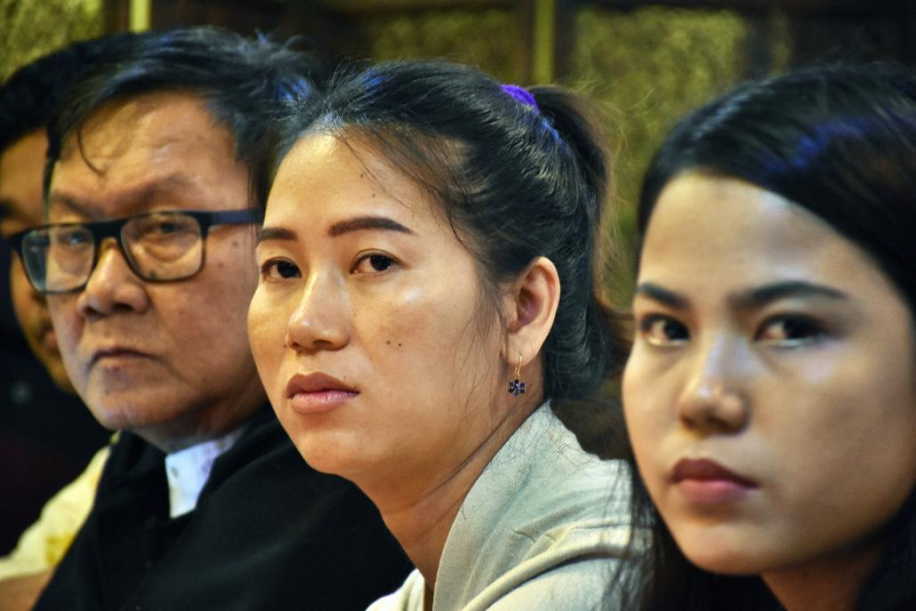 Lawyer Khin Maung Zaw (left), Wa Lone's wife Pan Ei Mon (centre) and Kyaw Soe Oo's wife Chit Su Win (right) speak at a press conference in Yangon on September 4. (Steve Tickner | Frontier)