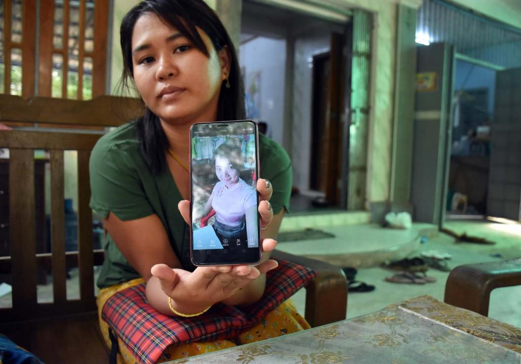 Ma Hnin Wai Thi shows a photo of the person she alleges she transferred the money to. (Steve Tickner | Frontier)