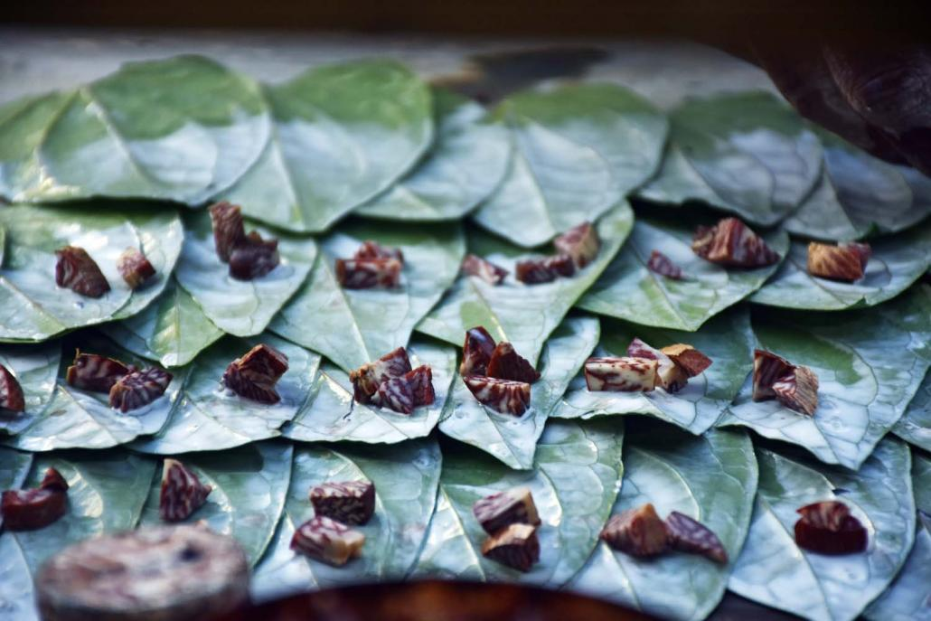 Quids of betel nut are lined up for sale in Yangon. Although a pack of five sells for just K200, vendors can make K50,000 or more a day. (Steve Tickner | Frontier)