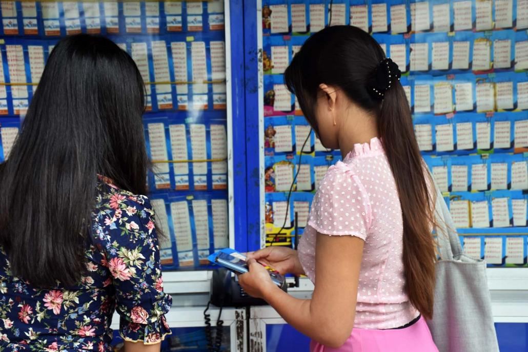 Although the lottery directorate says tickets should not be sold for more than K500, they typically retail for K600 in Yangon and K700 in rural areas. (Steve Tickner | Frontier)