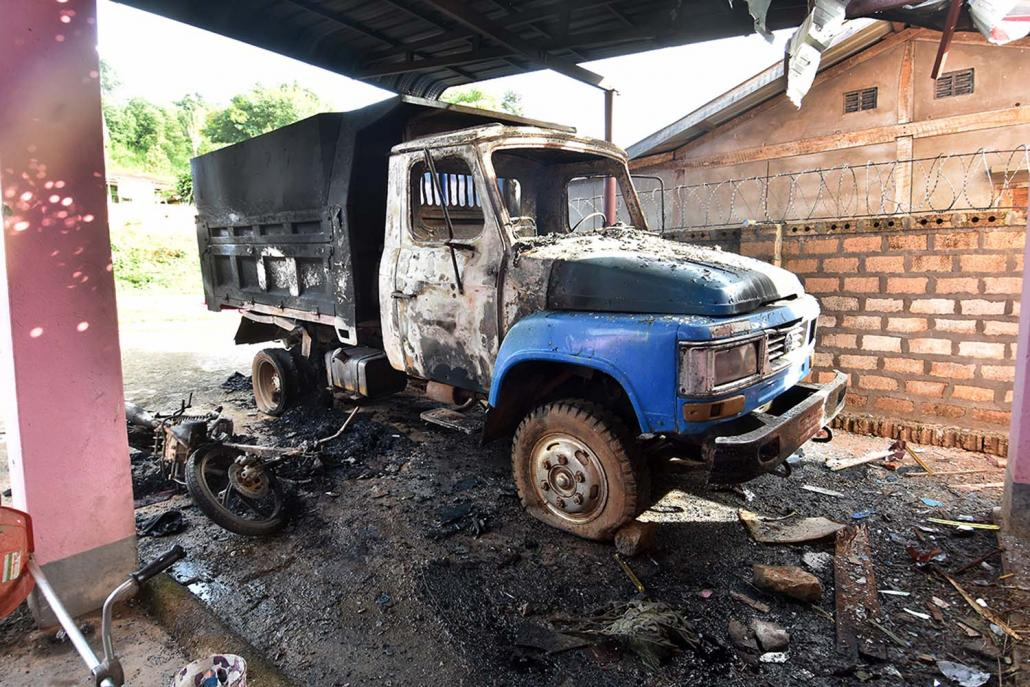 A truck and motorcycle destryoed during the assault on the home of Mai Yan militia leader U Win Maung. (Steve Tickner | Frontier)