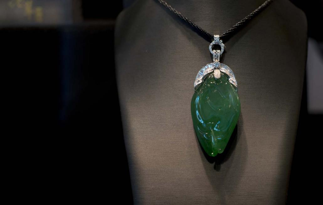 A pendant made from Myanmar jade on display at the Hong Kong Jewellery and Gem Fair in 2013. Although Myanmar law requires miners to sell their jade at emporiums in Nay Pyi Taw, most is instead smuggled to China. (AFP)