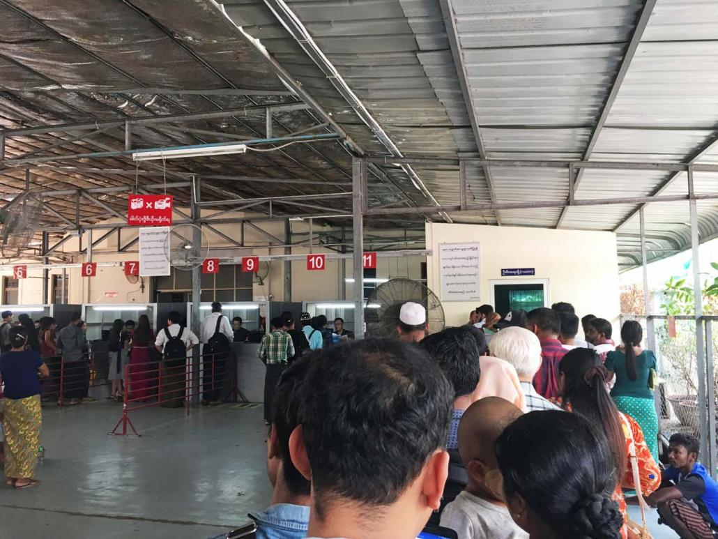 "At the passport office in Yangon, where Burmese Muslims and people of South Asian and Chinese descent – whom officials classify as being of ""mixed-blood"" – must form a separate queue and receive greater scrutiny. (Than Toe Aung 