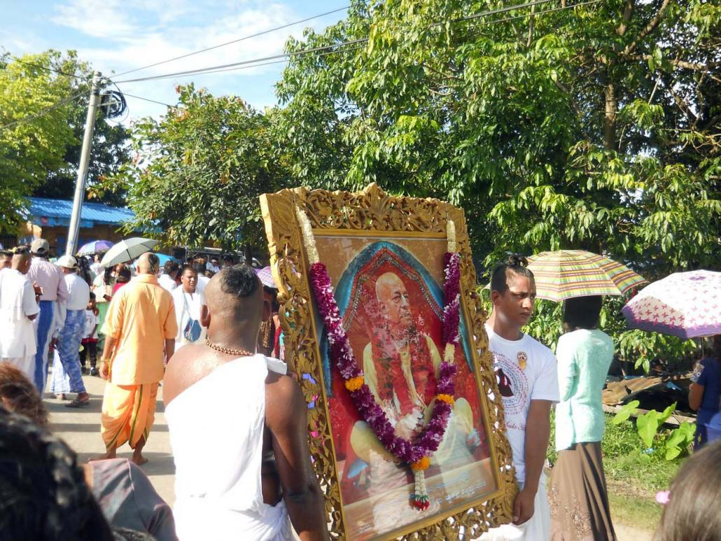 The biggest annual festival for Hare Krishna devotees in Myitkyina is the Ratha Yatra, a Hindu procession that happens in June or July. In this photo, devotees carry a portrait of A.C. Bhaktivedanta Swami Prabhupada. (Emily Fishbein | Frontier)