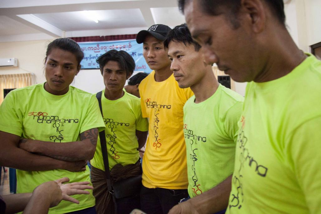 Former trafficking victims take part in an event in Yangon's Ahlone Township to mark Anti-Trafficking in Persons Day on September 13. The men were trafficked to a range of countries, including Thailand and Indonesia. (Theint Mon Soe — J / Frontier)