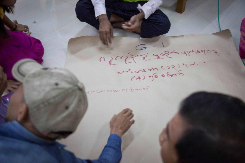 Former trafficking victims write down messages for the government outlining their needs for the future. (Theint Mon Soe — J / Frontier)