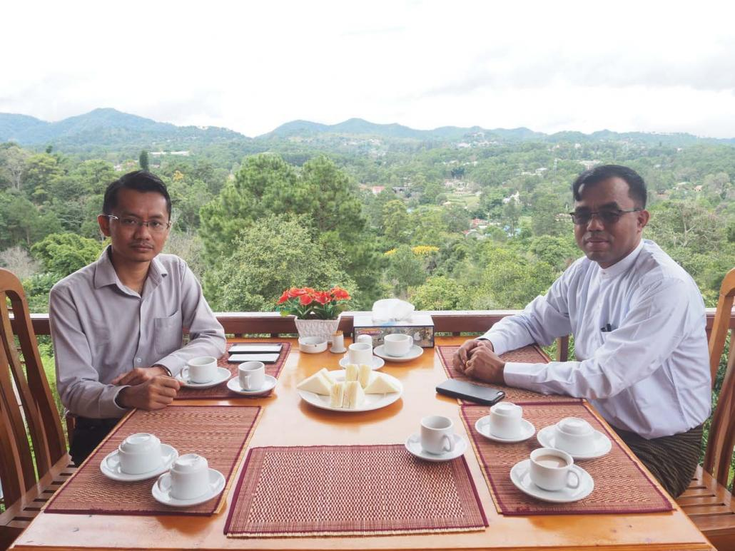 U Khin Maung Chin (right), chairman of the newly formed Kalaw Tourism Organisation and the organisation's secretary U Kyaw Soe Han at the Hill Top Villa Hotel. (Ben Dunant | Frontier)