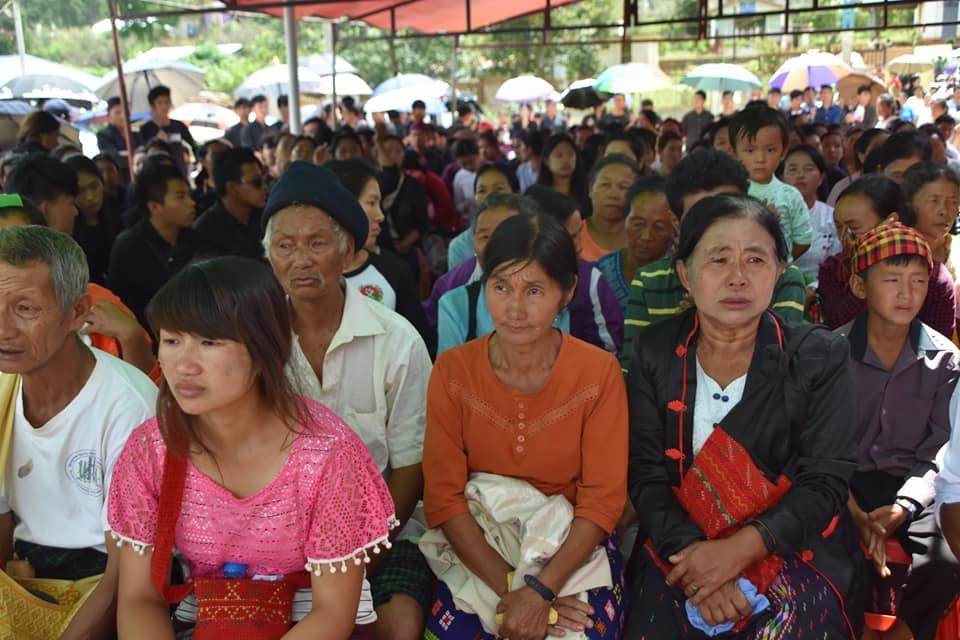 Mourners attend a funeral at the Christian cemetery in Kutkai on September 1 for the five ethnic Kachin civilians who were killed by shelling early on August 31. (Kan Thar | Facebook)