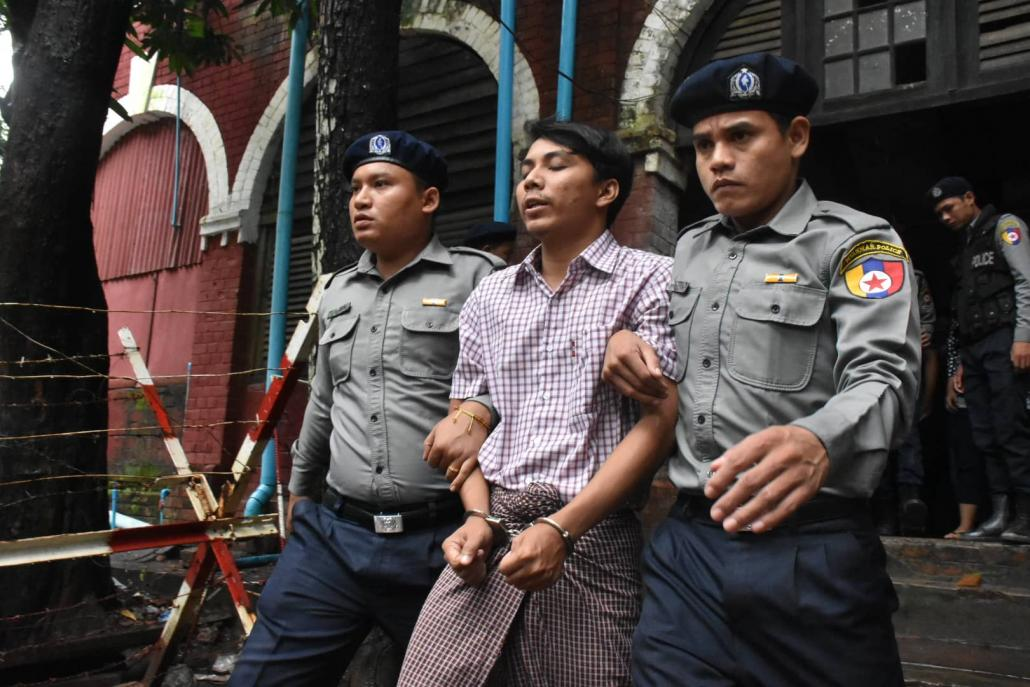 Ko Kyaw Soe Oo is escorted by police from the courtroom today. (Steve Tickner | Frontier)