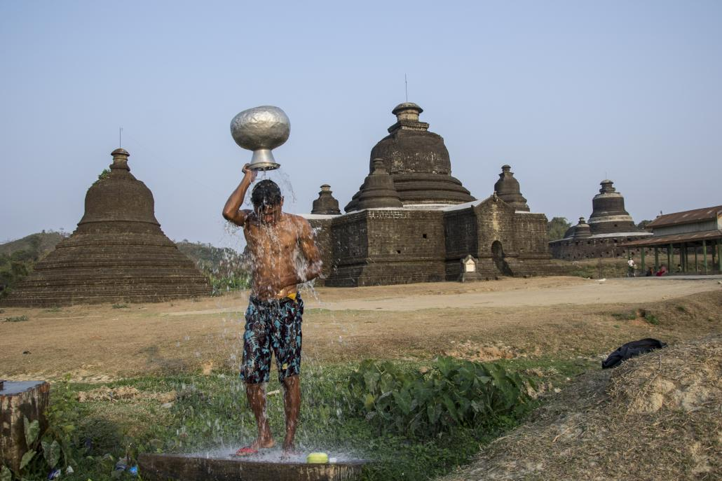 A man washes himself outside a Mrauk U temple. (Mratt Kyaw Thu / Frontier)