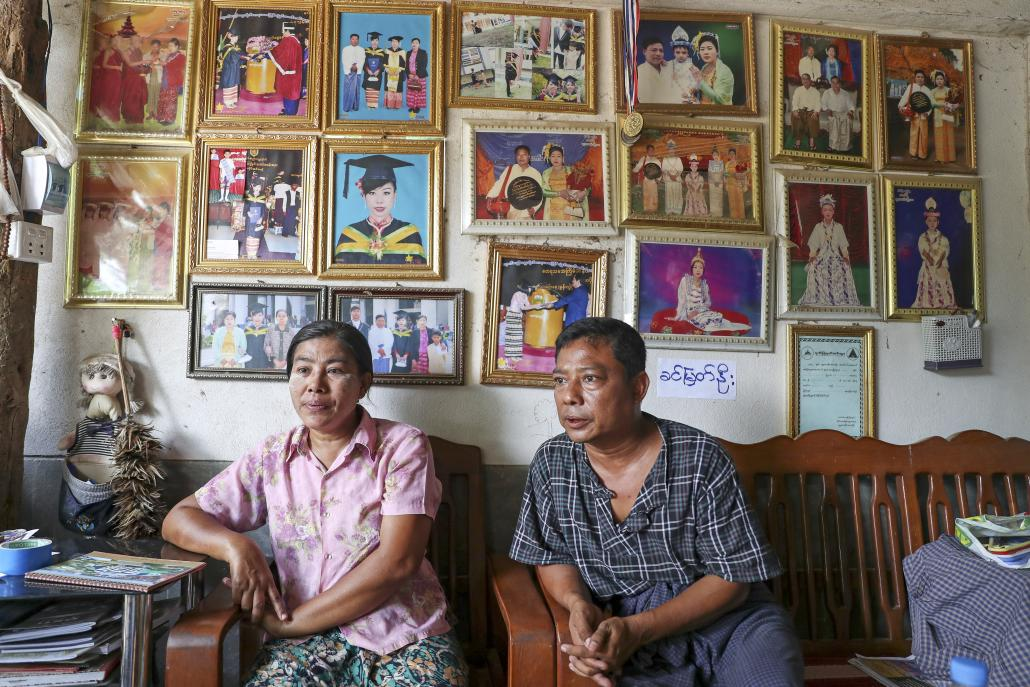 The parents of jailed plantation staff member Ma Shun Le Myat Noe, Daw Yi Win (Left) and U Myo Min Aung, at their home in Myotha West village. (Nyein Su Wai Kyaw Soe | Frontier)