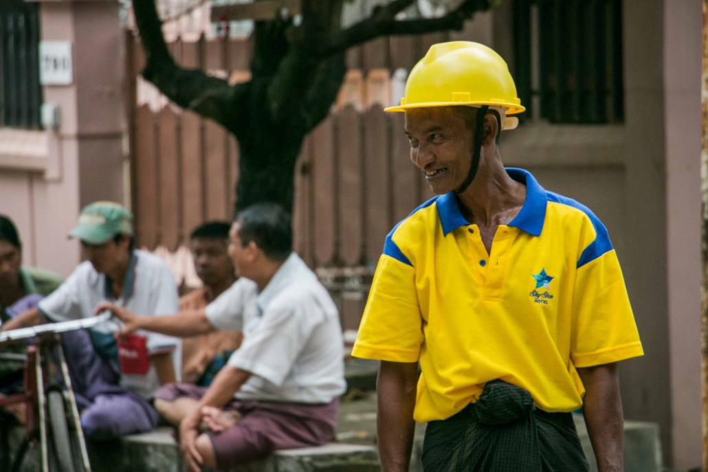 Trishaw driver Ko Naing works as a volunteer clearing traffic in a busy street in Yangon's Tarmwe Township. (Nyein Su Wai Kyaw Soe / Frontier)