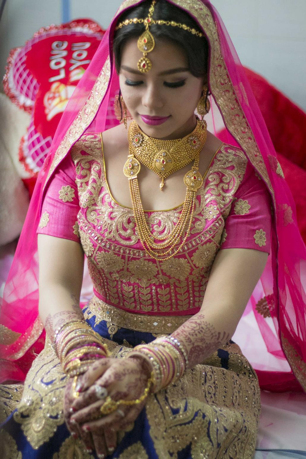 Bride Shilpa Pradhan, 23, is Gorkha-Buddhist but agreed to a Hindu-style wedding at the request of her husband's family. (Nyein Su Wai Kyaw Soe | Frontier)