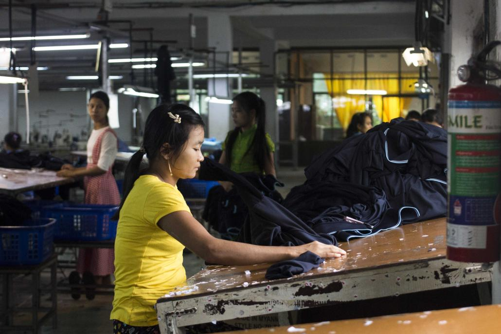 A worker at a garment factory in Hlaing Tharyar Industrial Zone, on the western outskirts of Yangon. (Nyein Su Wai Kyaw Soe | Frontier)