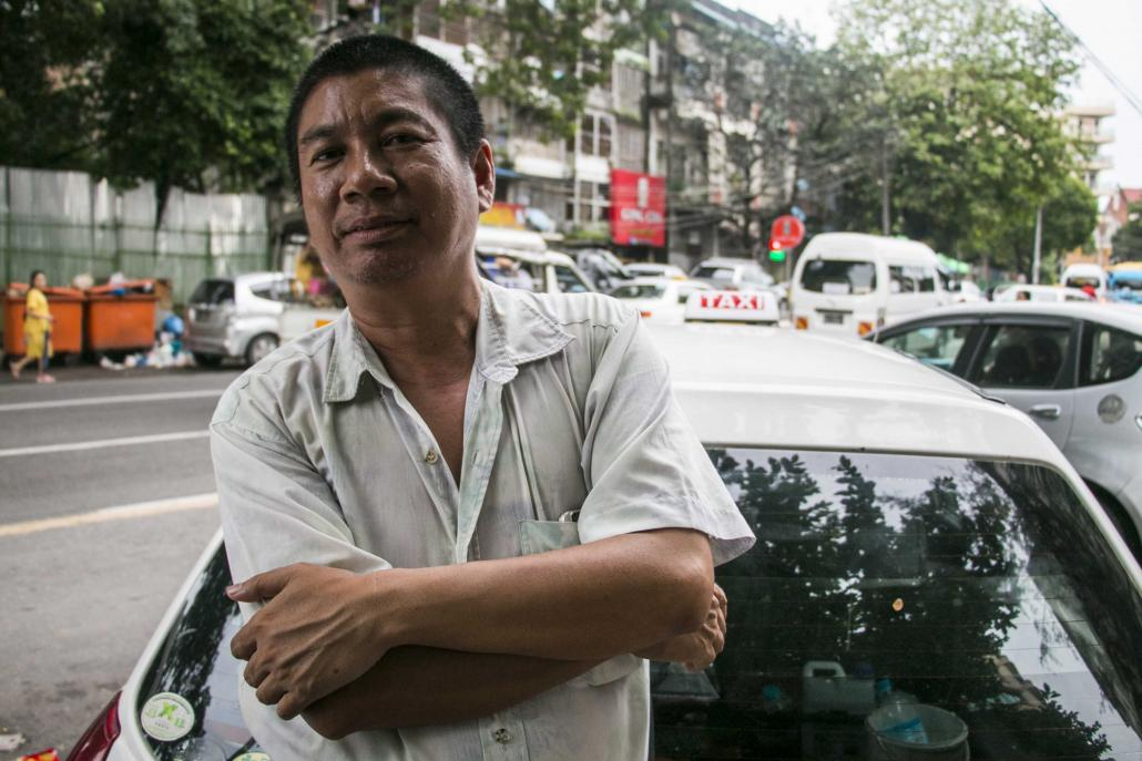 Taxi driver U Aung Htwe says he is considering signing up for a ride-hailing service. (Nyein Su Wai Kyaw Soe | Frontier)