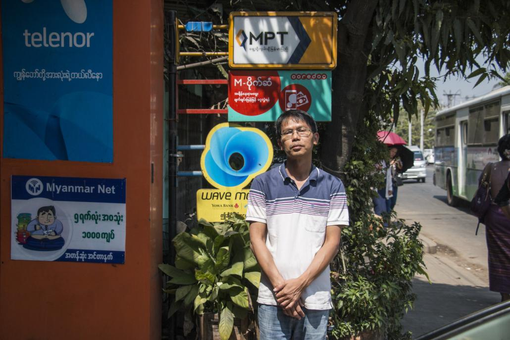 Ko Aung San Thwin owns a small mobile phone store in Hlaing Township and is an agent for various mobile money operators (Nyein Su Wai Kyaw Soe | Frontier)