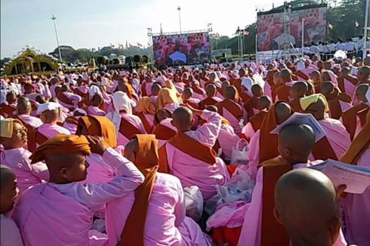 Nuns watch the Shwedagon ceremony from People's Park on January 1. (Sai Zaw | 7 Day)