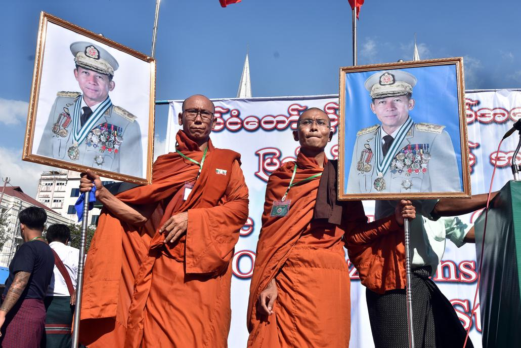 Monks hold images of Senior General Min Aung Hlaing during a pro-Tatmadaw rally in Yangon on October 14, 2018. (Steve Tickner | Frontier)