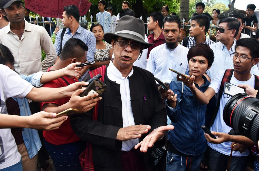 High Court lawyer U Robert San Aung talks to reporters outside the court. (Steve Tickner | Frontier)