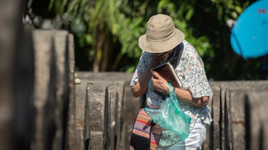 Ms Mozelle Friedman walks through Yangon's Jewish cemetery. After locating the grave of her great-grandmother, she said a prayer and wept. (Rajiv Raman | Frontier)