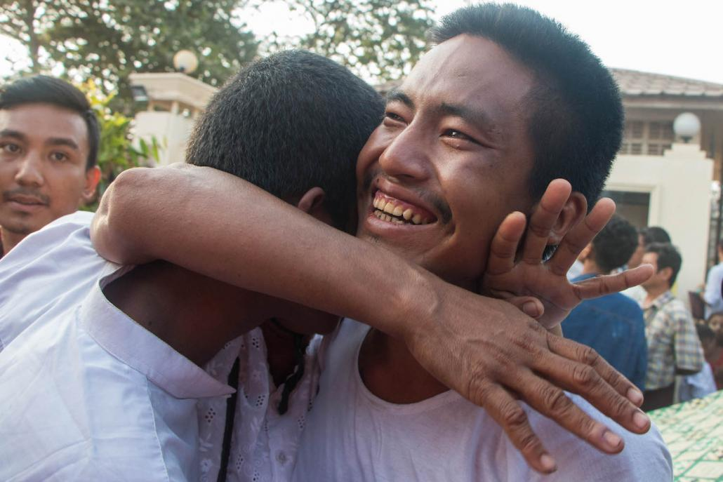 A mothers hug two of her sons who were freed from Insein Prison on April 17. (Thuya Zaw | Frontier)
