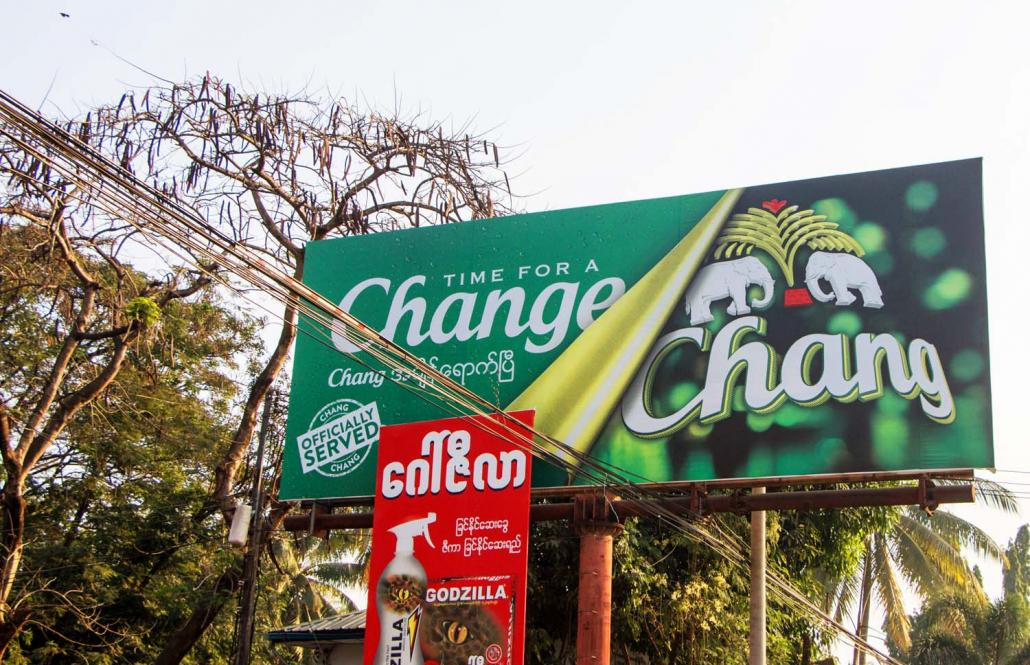 "The only sign in Myawaddy that Chang is being brewed in Myanmar are billboards announcing it is now ""officially served"". (Thuya Zaw 