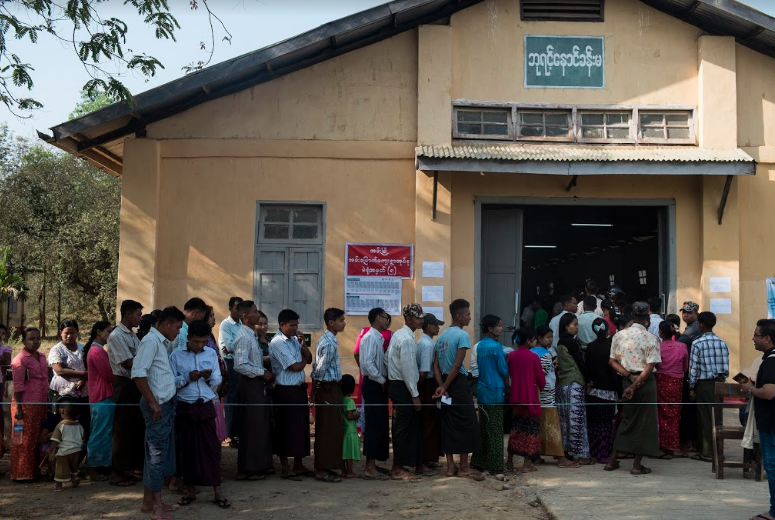 Voters queue up at a village polling station in Ann early on Saturday morning. (Teza Hlaing | Frontier)
