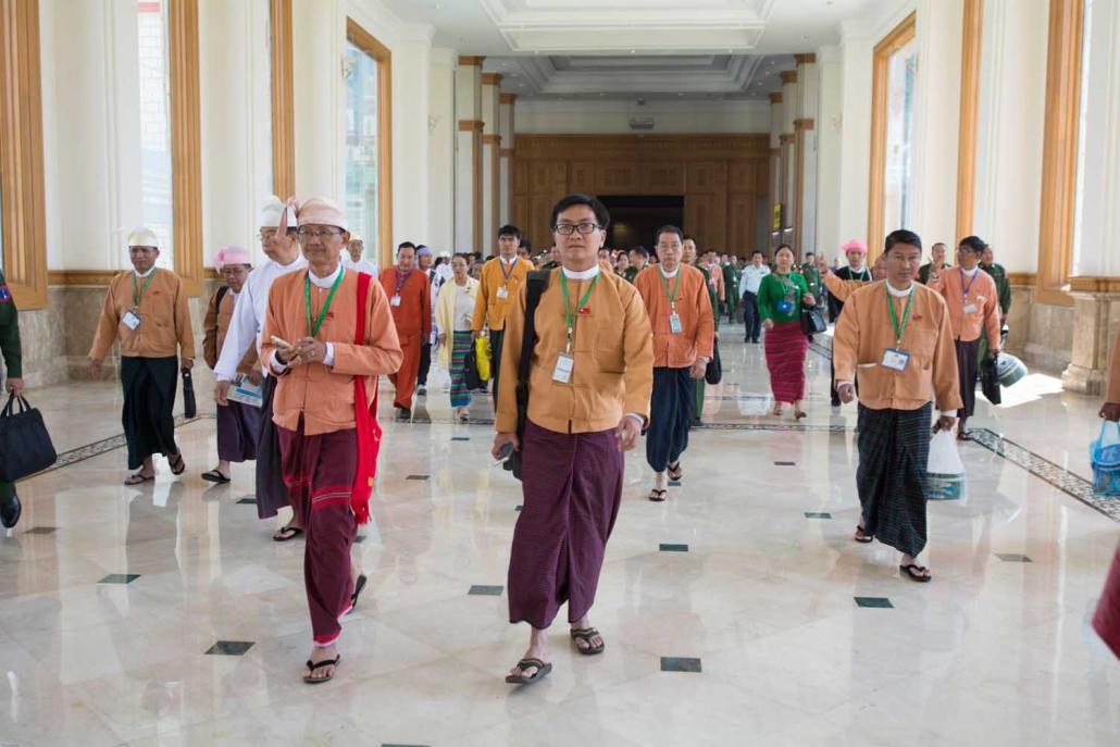 Lawmakers walk through the corridors of parliament in Nay Pyi Taw on January 31, 2016, the day they were sworn into office. (Teza Hlaing | Frontier)