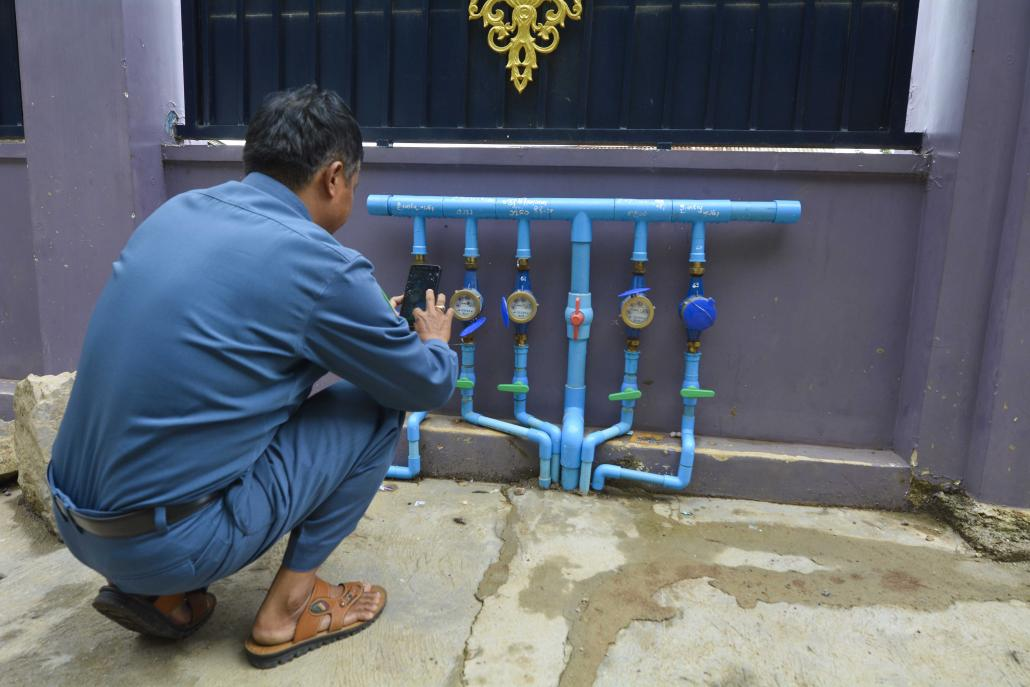 An official uses the application on a water meter in Taunggyi. (Teza Hlaing | Frontier)