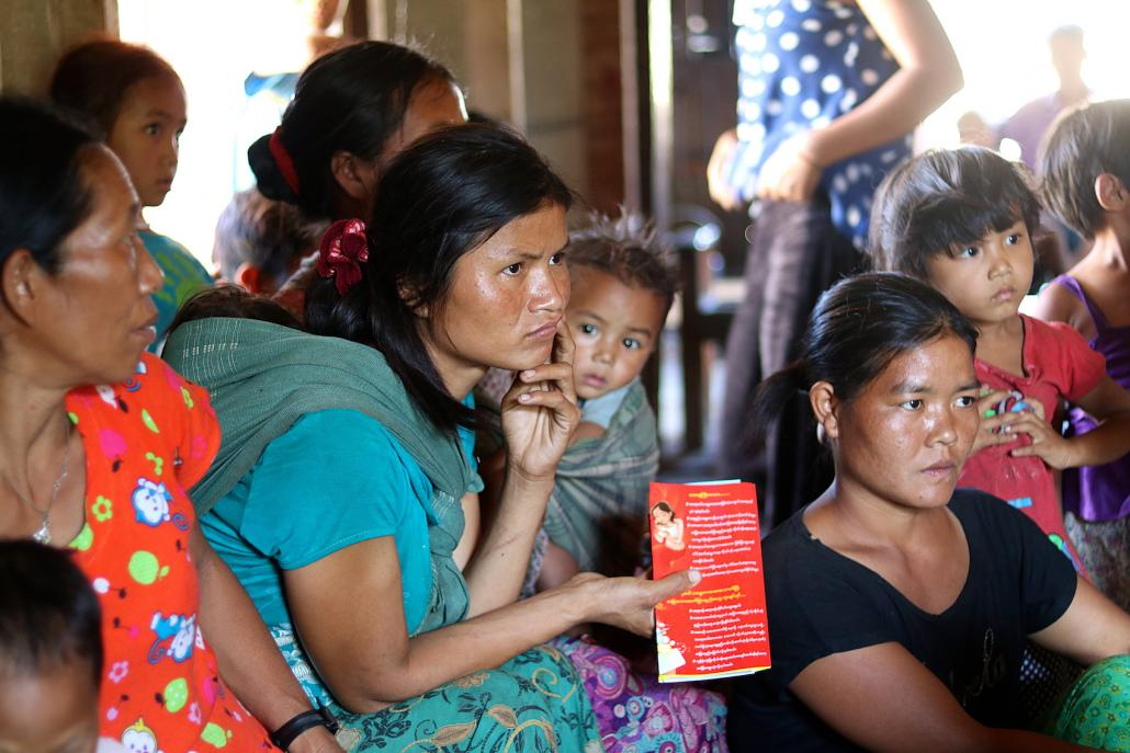 A group of women listen to a presentation by Marie Stopes International about reproductive health in Chin State. (Charlotte England / Frontier)